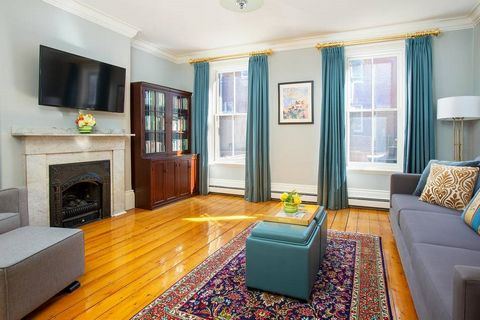 Amos Brown House, ca.1863. This stunning 4BR/2.5BA brick single family home is tucked just off Monument Square and features 2,700+sf of living space with beautiful period details and soaring ceilings throughout. The main level features a gorgeous for...