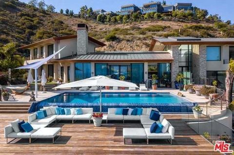 Detailed Description: Just under 25,000 sqf this pristinely maintained and fenced compound with state of the art upgrades, smart home features and security cameras. Solar maintains the entire property with additional solar for pool. Only minutes to D...