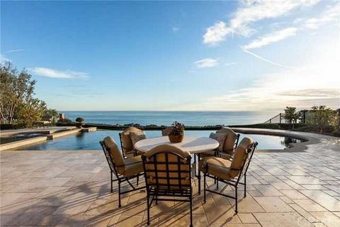 Detailed Description: This is it! The home with the view in the private gated community of Pelican Crest, on the highly sought-after front row Avalon Vista, is available. Mst. Includes separate water closets, bath facilities and closets, covered terr...