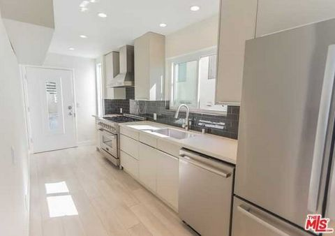Detailed Description: Breathtaking Views! Absolutely stunning, fully renovated loft at the highest point in Venice. Very private two story condo with a lot of natural light. Private two car attached garage with separate laundry room. Entertain your g...