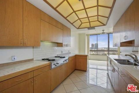 Detailed Description: Contemporary luxury living at The Mirabella. On site manager, front desk, valet parking, pool. 8th floor south and west facing unit on the tranquil side of the building away from Wilshire Blvd. Unit has huge master suite with dr...