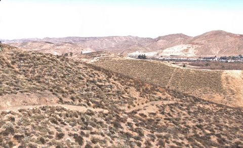 Located in Lake Elsinore. This is a large hillside property with scenic views of the surrounding area below.