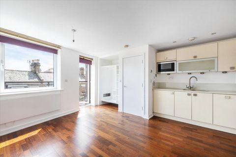 A bright and well-proportioned studio flat with private South facing terrace. Set on the second floor of this purpose-built building. Benefits include timber style flooring, a kitchen with composite stone work surfaces and integrated appliances, A fu...