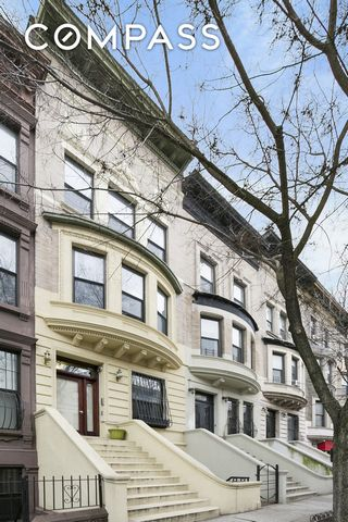 HIGH INCOME GUARANTEED AND SECURED FOR IMMEDIATE HIGH RETURN....( $150,500/year) This incredible and unique legal three-family brownstone is in pristine condition and provides all modern amenities. The owner's duplex with garden and cellar underwent ...