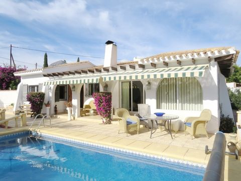 Beautifully presented traditional style villa set on a 1000 m2 plot on a desirable street in Alfaz del Pi. The property is walled and gated. The gardens are well kept and Mediterranean with Fruit and Almond trees. There is a summer kitchen with gas h...