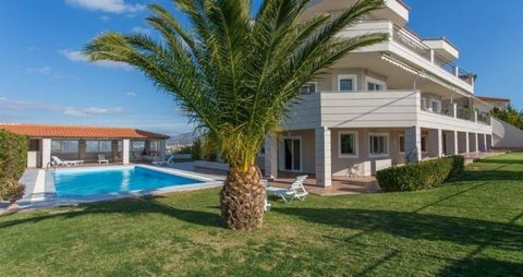 Perched on a high hill in the sought after area of Lagonissi, the villa enjoys ecstatic views of the Athenian Rivera coast and the Saronic Gulf.