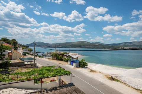 This is a cosy 1-bedroom apartment in Arbanija. It offers a great sea view and is perfect for a seaside vacation with family.The home is 4 km away from picturesque town of Trogir. The sea beach with its crystal-clear waters is just 10m away. You will...