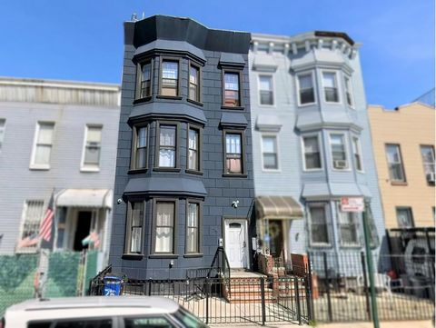 INVESTOR FRIENDLY! This STUNNING renovated multi-family townhouse is a must-see. Located in beautiful eclectic Bushwick is a spacious 3-family home boasting bright rooms, gorgeous chefs granite kitchens with stainless steel appliances, fully tiled ba...