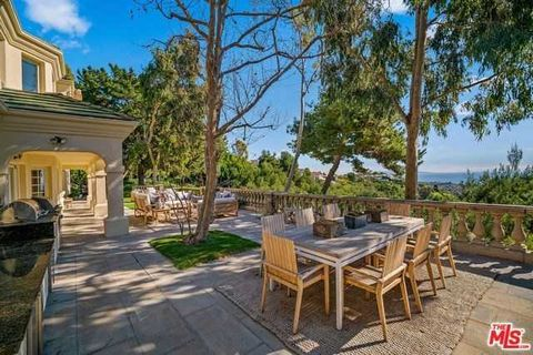 Detailed Description: Magnificent Mediterranean 6 bed, 6 bath villa in the prestigious gated Ridgeview Country Estates. Sweeping unobstructed views of the ocean, vineyards, and lush landscaping with citrus trees and terraced gardens surround this bea...